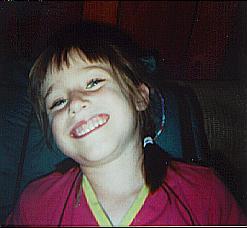 Celeste grinning