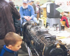 Small railfan checking out a really big model locomotive