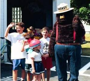 Smokey The Bear with some local kids